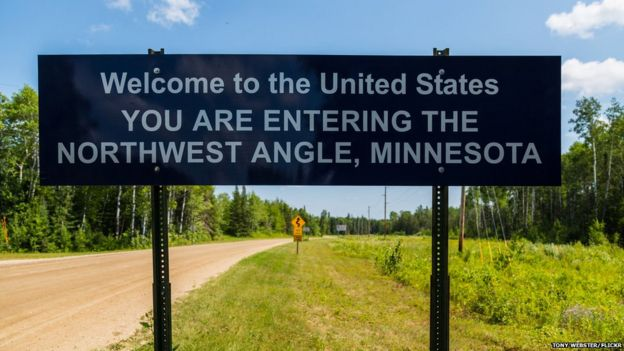 A sign marks the entrance to the Northwest Angle of Minnesota, from rural Manitoba, Canada.