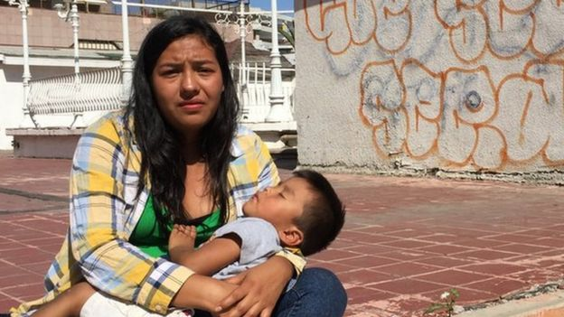 A mother and her sleeping son in the Mexican border town of Tijuana, 29 April 2018