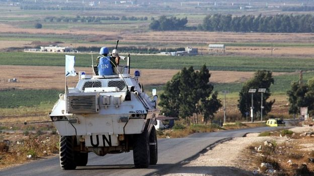 Vehicles of a convoy United Nations Interim Forces in Lebanon (UNIFIL) ride on a road along the border between Lebanon and Israel