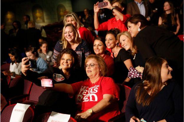 Cruz supporters snap a selfie ahead of the September debate