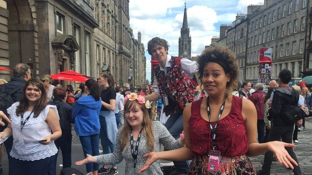 Performers on the Royal Mile hand out leaflets
