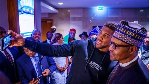 Anthony Joshua taking a selfie with Muhammadu Buhari