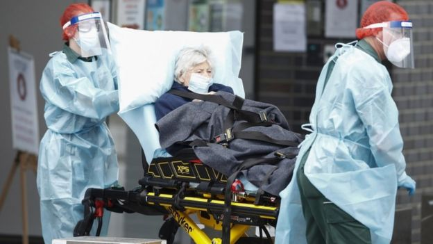 A resident of the Epping Gardens Aged Care Facility is taken away in an ambulance in Epping, outskirts of Melbourne, Australia