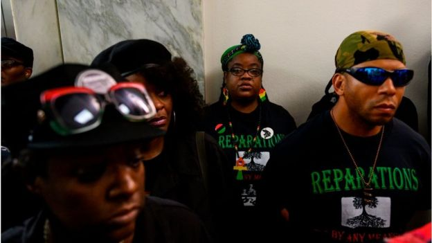 Activists stand in line waiting to enter a hearing