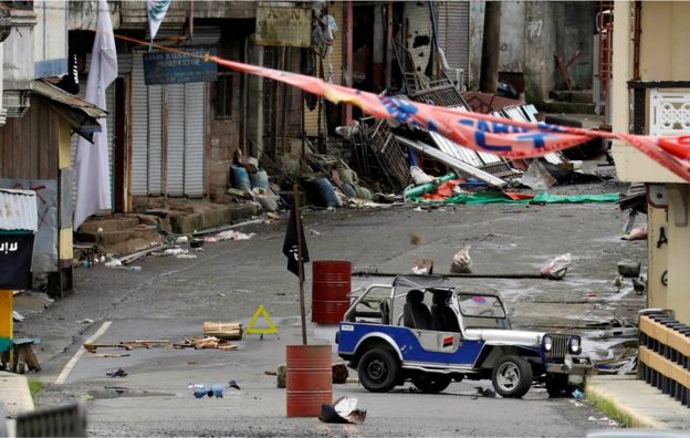 A view of the Maute group stronghold with an IS flag in Marawi City in southern Philippines 29 May 2017.