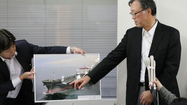 Kokuka Sangyo president Yutaka Katada points to a photograph of the tanker Kokuka Courageous (13 June)