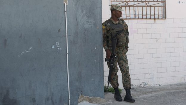 A soldier on patrol in a side street that leads from Spanish Town Road into Denham Town
