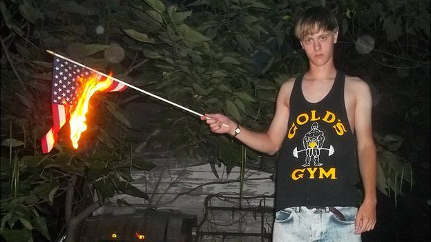 An image appearing to show Charleston church shooting suspect Dylann Roof burning a US flag - 11 May 2015