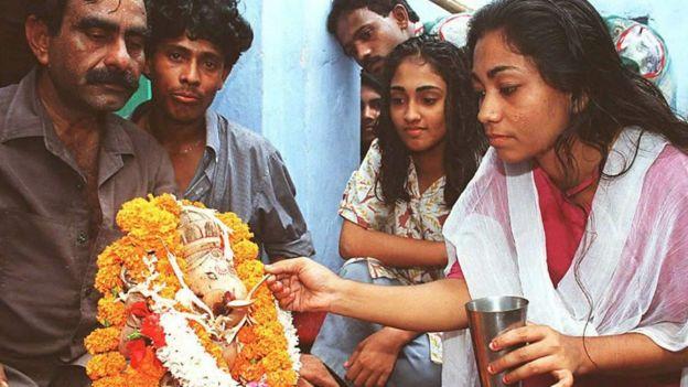 Hindus offering milk to Lord Ganesha