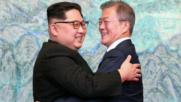 North Korean leader Kim Jong Un (L) and South Korean President Moon Jae-in (R) pose (hug, hugging, hugs) for photographs after signing the Panmunjom Declaration for Peace, Prosperity and Unification of the Korean Peninsula during the Inter-Korean Summit at the Peace House on April 27, 2018 in Panmunjom, South Korea.
