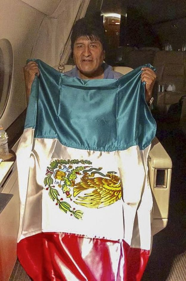 A handout picture released by the Mexican Foreign Ministry press office shows former Bolivian President Evo Morales leaving Bolivia in an aircraft of the Mexican Air Force on 11 November, 2019.