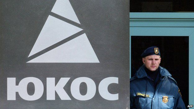 Yukos logo/Russian policeman - file pic