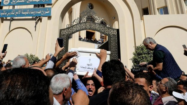 Mourners carry a coffin during the funeral of Coptic Christians who were killed in an attack, in Minya, Egypt November 3, 2018