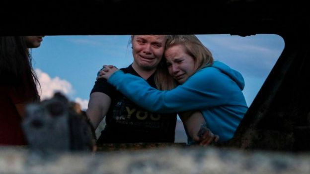 Relatives mourning victims of the shooting