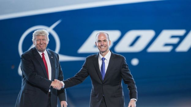 President Donald Trump, left, is introduced by Boeing's chief executive officer Dennis Muilenburg during the debut event for the Dreamliner 787-10 at Boeing's South Carolina facilities on February 17, 2017