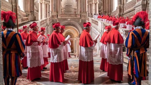 A scene from the film of cardinals lined up