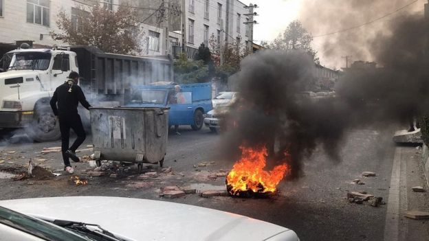 Protesters set fire as they block the roads during a protest against gasoline price hike at Damavand of Tehran, Iran on November 16, 2019.