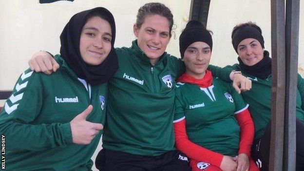 Kelly Lindsey with Afghanistan players