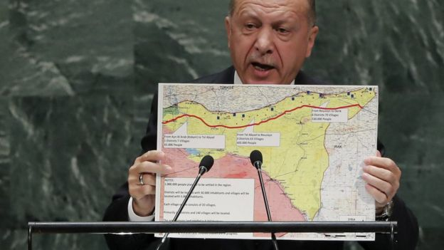 Turkish President Recep Tayyip Erdogan holds up a map showing his proposed