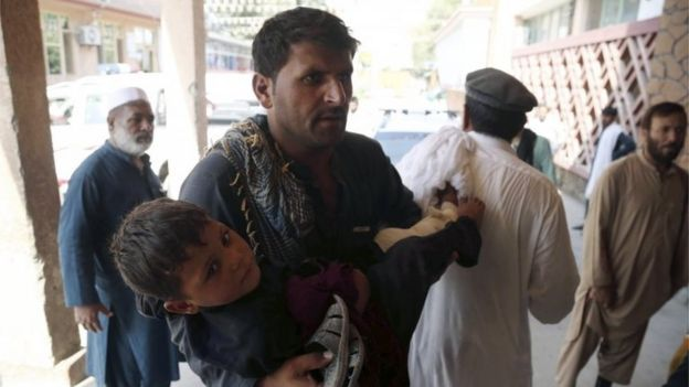 A young boy who was injured in a twin suicide bomb blasts, that targeted girl's schools, is rushed to a hospital to receive medical attention in Jalalabad, Afghanistan, 11 September 2018.