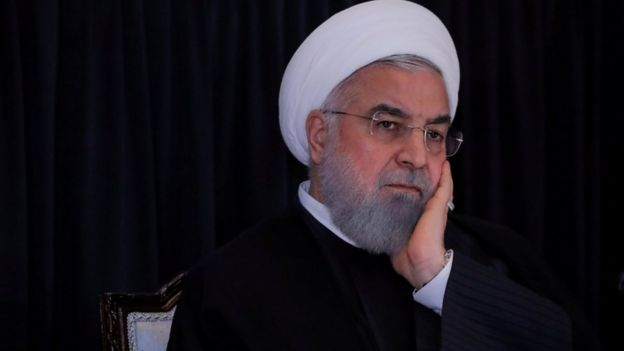 Rouhani with head in hands
