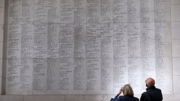 People look at the names of some of fallen soldiers on the Menin Gate in Ypres