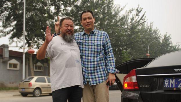 中國異議人士艾未未(左)與維權律師浦志強(右)