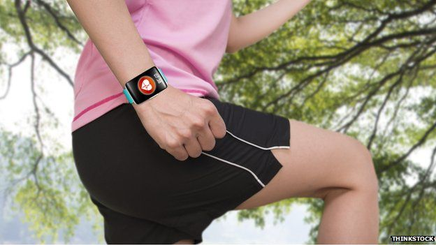 runner wearing fitness band