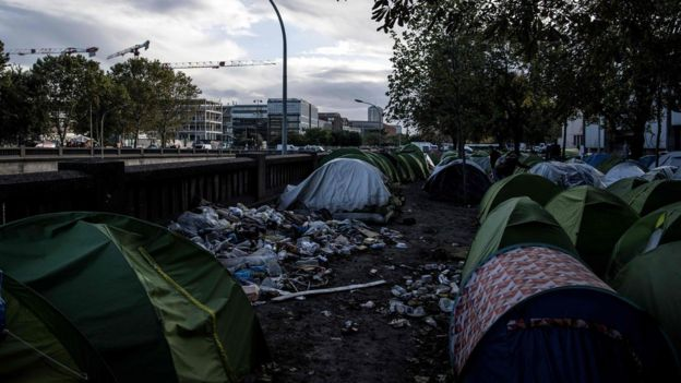 Parisians have become used to seeing make-shift camps beside the ring road at Porte de la Chapelle in north-east Paris
