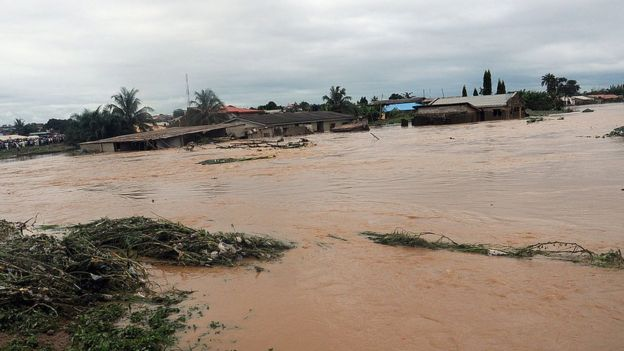 This picture taken on August 27, 2011 shows floodwaters coursing through Ibadan, Odo Ona, in Oyo State.