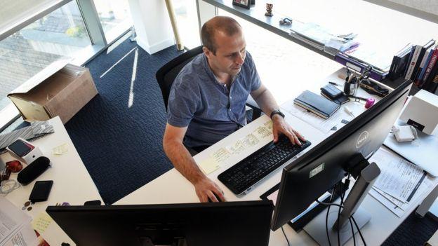Ron Ashtiani at work at his computer
