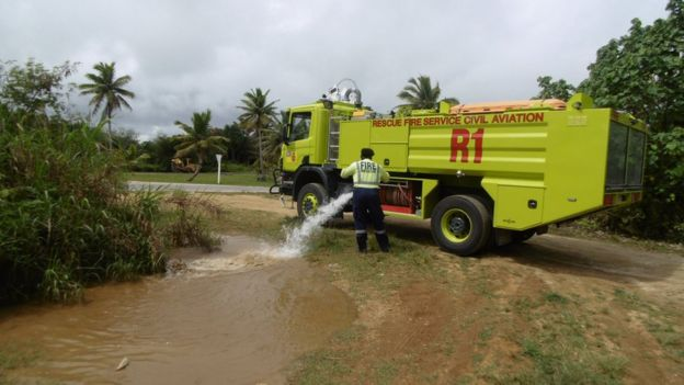The island's fire brigade topping up Trevor's puddle