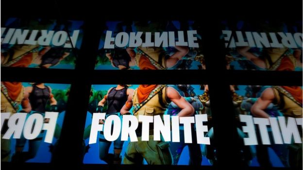 This illustration picture shows the video game Fortnite logo displayed on a tablet in Paris, on February 18, 2019