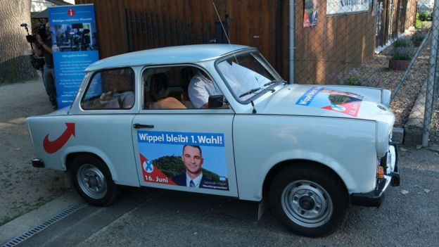 A car decorated with election campaign posters for Sebastian Wippel, mayoral candidate of the right-wing Alternative for Germany (AfD)