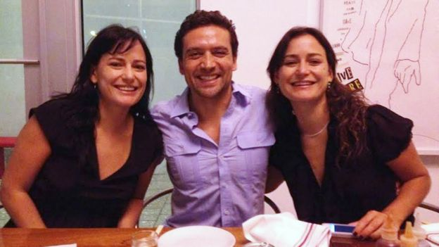 Natalia (left) with her twin sister, Carolina, and a friend