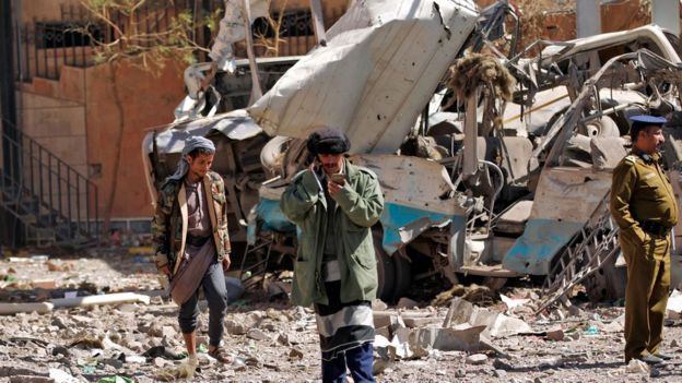 People at site of air raid in Yemeni capital Sanaa on February 5, 2018