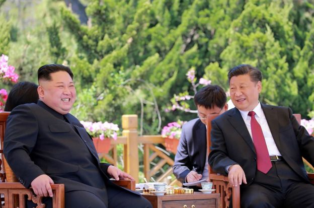 "This file picture from North Korea""s official Korean Central News Agency (KCNA) taken on May 8, 2018 and released on May 9 shows China""s President Xi Jinping (R) and North Korean leader Kim Jong Un during a meeting in the Chinese city of Dalian. Dubbed a ""world-class poker player"" in diplomacy by Donald Trump, Chinese leader Xi Jinping may hold the best cards after the US leader scrapped his planned summit with North Korean leader Kim Jong Un. / AFP PHOTO / KCNA VIA KNS / KCNA VIA KNS"