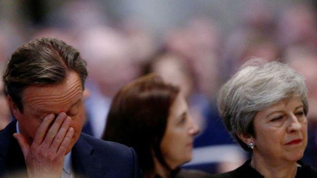 David Cameron y Theresa May