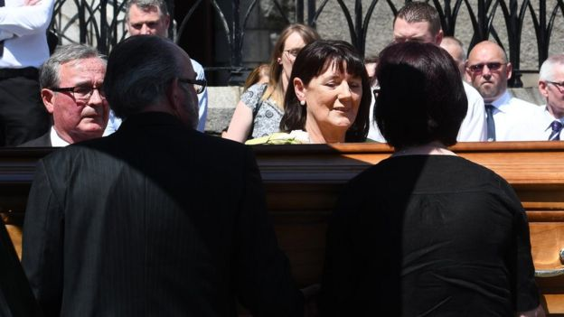 Family and friends carry Seamus Ruddy's coffin