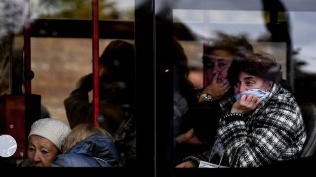 Synagogue visitors react in a bus after surviving a shooting at a synagogue in Halle, Germany