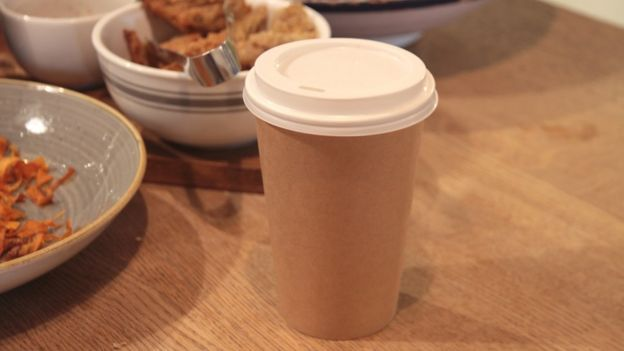 Compostable coffee cup on table