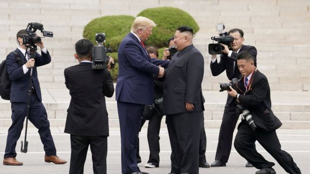 US President Donald Trump meets North Korean leader Kim Jong-un at the demilitarised zone separating the two Koreas, in Panmunjom, South Korea, 30 June, 2019