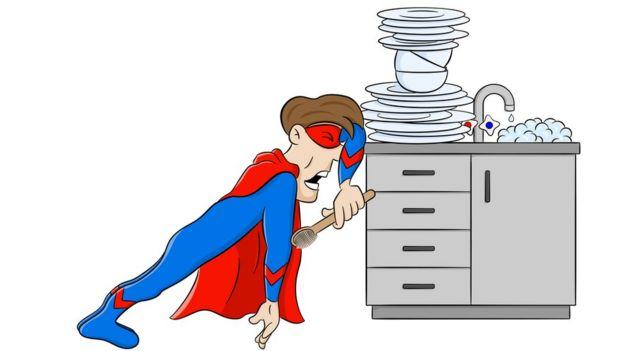 Superhombre llorando frente a platos sucios