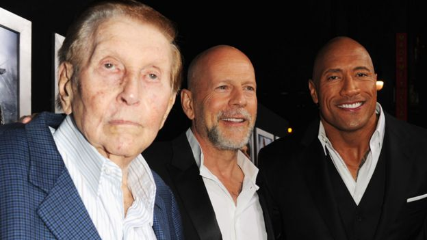 "Redstone with Bruce Willis and Dwayne ""The Rock"" Johnson in 2013"