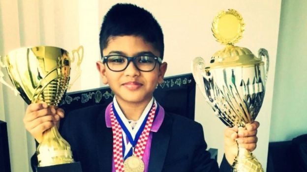 Shreyas Royal holding two trophies