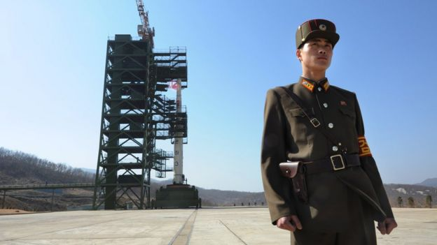 In this file photo taken on April 8, 2012 a North Korean soldier stands guard in front of a Unha-3 rocket at the Sohae Satellite Launch Station in Tongchang-ri.