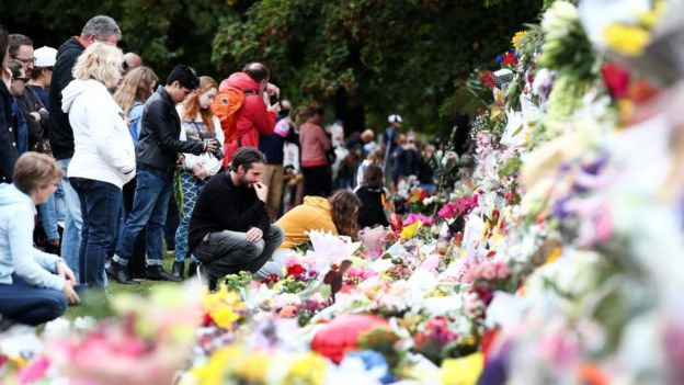 People lay flowers in Christchurch