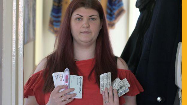 Kim holding medicines