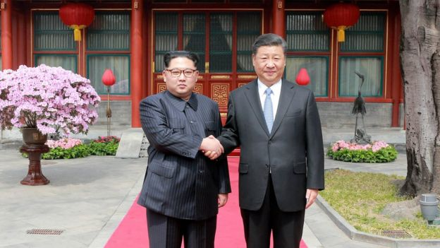 North Korean leader Kim Jong Un shakes hands with Chinese President Xi Jinping, as he paid an unofficial visit to Beijing, China,