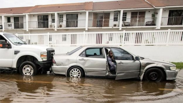 A car sits in a flooded street in the Bahamas after Hurricane Dorian, September 2019